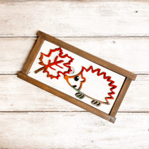 Cute hedgehog and leaf wood sign